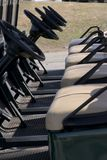 Ready Golf Carts. Electric Golf Carts waiting in line Royalty Free Stock Photography