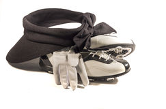 Ready for Golf. Picture of stylish golf visor. golf shoes and glove Royalty Free Stock Photography