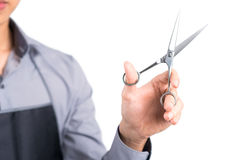 Ready for hairdo. Close-up image of a hand holding professional stylist�s scissors against a white background Stock Image