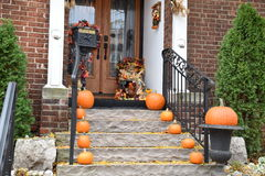 Ready for Halloween: An Assortment of Pumpkins on the Front Steps and Porch of A House Stock Photography
