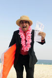 Ready  for  a  holiday: businessman on the beach Royalty Free Stock Photography