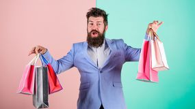 Ready for holiday. Buy gifts in advance. Enjoy shopping black friday. Hipster shopping with discount. Man bearded. Hipster businessman formal suit carry paper stock photo