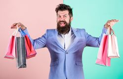 Ready for holiday. Buy gifts for everyone. Buy gifts in advance. Enjoy shopping black friday. Hipster shopping with. Discount. Man bearded hipster businessman royalty free stock images