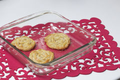 Ready homemade cakes. Strips of puff pastry, woven into a pigtail. Preparation of baking Royalty Free Stock Image
