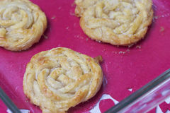 Ready homemade cakes. Strips of puff pastry, woven into a pigtail. Preparation of baking Royalty Free Stock Photos