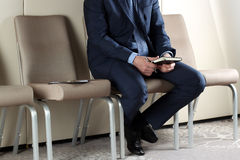 Ready for interview. Thoughtful man in formalwear  sitting at th Stock Images