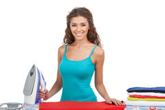 Ready for ironing. Beautiful young women holding an iron while s Royalty Free Stock Photography