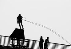 Ready for a jump. Ropejumper getting ready on a bridge stock photo