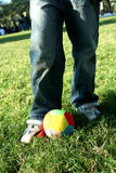 Ready for a kick. Getting ready for a kick with a coloured ball stock photo