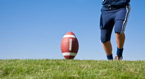 Ready for a Kickoff. American Football Kickoff close-up photo. Athlete ready to kick the ball. Horizontal with lots of Copy Space Stock Images