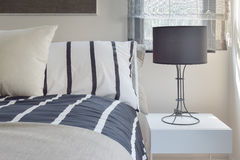 Ready lamp with black shade lamp on bedside table Royalty Free Stock Photo