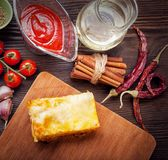 Ready lasagna and its ingradent. On a wooden table stock image