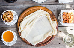 Ready made dough leaves, fillo, phyllo used for baklava, nuts an Stock Photo
