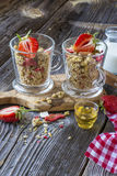 Ready-made granola with dried strawberries and almonds. Healthy breakfast  cereal muesli,   fresh Royalty Free Stock Photos