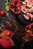 Ready made nourishing salad on dark background Royalty Free Stock Images
