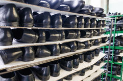 Ready-made pairs of shoes. A stack of shoes at a shoe factory Royalty Free Stock Photo