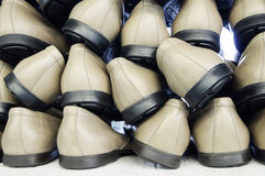 Ready-made pairs of shoes. A stack of shoes at a shoe factory Stock Image