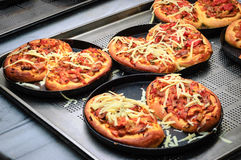 Almost ready mini pizzas Stock Photo