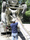 Ready Mix Washing. Man Washes out ready-mix concrete truck stock images