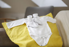 Ready for the New Baby!. Baby clothes in modern stylish home Waiting for the new baby Stock Photo