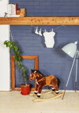 Ready for the New Baby!. Baby clothes and rocking horse toy in modern stylish interior. Waiting for the new baby Stock Images