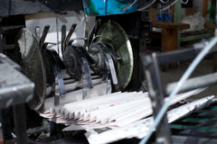 Ready newspaper on production line in a print shop Royalty Free Stock Photo