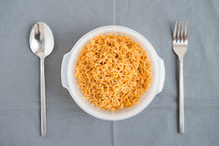 Ready noodle with fork and spoon are prepare Stock Images