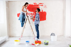 Ready for painting, couple renovation new home. Ready for painting, young couple renovation new home stock photos