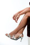 Ready for party!. Close-up of a woman's legs and arms with elegant accessories Royalty Free Stock Photos