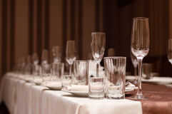 Ready for party: Restaurant table layout with row og wineglasses Royalty Free Stock Images