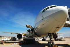 Ready passenger plane of lift-off. The passenger plane assumes front lift-off preparation job in course of , the passenger enters a cabin exactly and loads and Royalty Free Stock Photography