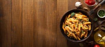 Ready pasta on wood. En background Stock Photo