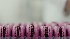 Ready pink macarons with jam in packaging, close-up view stock video