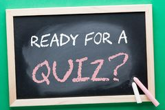 Ready For a Quiz Concept. READY FOR A QUIZ question written on blackboard and color chalks. Business concept royalty free stock image