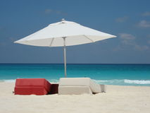 Ready for relax. Two cushions lying on the beach waiting for somebody to relax on them stock images