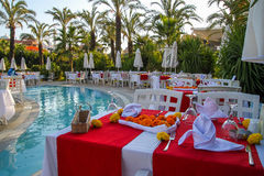 Ready romantic dinner next to the pool. Royalty Free Stock Photos