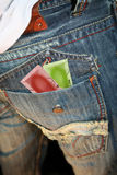 Ready for safe sex. Condoms waiting patiently in a mans denim pocket Stock Image