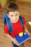 Ready for school. Boy ready for school with books and school backpack Stock Image