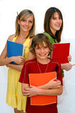 Ready for school. Three happy kids with school supplies on a white background