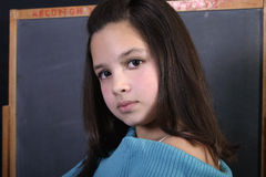 Ready for school. Closeup of adolescent girl in classroom setting Stock Image