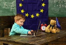 Ready for school. Little boy use laptop, ready for school. Child ready for school in classroom with eu flag. Computer. Technology for ready for school. Hooked Royalty Free Stock Photos