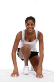 Ready Set Go!. Pretty African American teenage girl, posing in runners starting position and smiling Stock Image