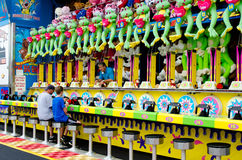 Father and son playing carnival games  Stock Images