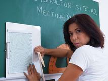Pretty woman in front of chalkboard royalty free stock photos