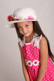 Ready for spring. Girl in spring outfit, including pink dress and white hat Stock Photos