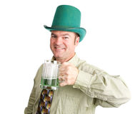 Ready For St Patricks Day. Irish man drinks green beer to celebrate St. Patrick's Day.  Isolated on white Royalty Free Stock Photo