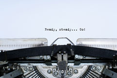 Ready. steady. go. slogan taped words on a vintage typewriter Stock Photos