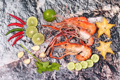 Ready streamed large fresh prawns and spicy sour herb. Royalty Free Stock Photos