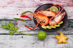 Ready streamed large fresh prawns and spicy sour herb. Royalty Free Stock Photo