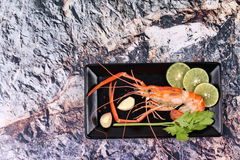 Ready streamed large fresh prawns and spicy sour herb. Stock Photos